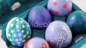 Painted Easter eggs in the carton