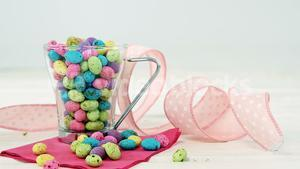 Mug filled with painted chocolate Easter eggs