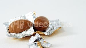 Chocolate Easter eggs in foil on white background