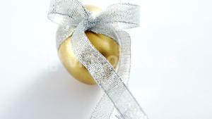 Golden Easter egg tied with ribbon on white background