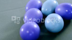 Blue and purple painted Easter eggs on colored background