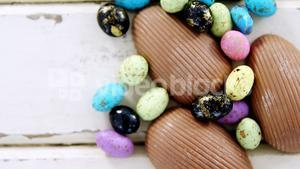 Chocolate Easter eggs on wooden plank