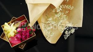 Opened gift box with a flowers