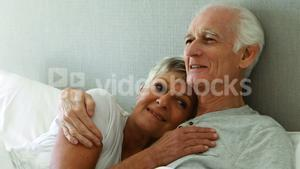 Senior couple relaxing in the bedroom