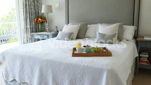 Breakfast tray on bed in bedroom