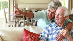 Senior couple interacting with each other in the living room