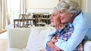 Senior couple watching tv together in living room