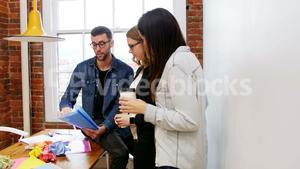 Team of business executives discussing at desk