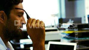 Tired business executive sleeping on his desk