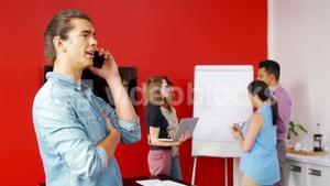 Male executive talking on mobile phone in the conference room