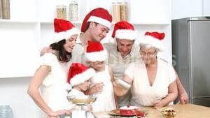 Family doing their Christmas baking in the kitchen