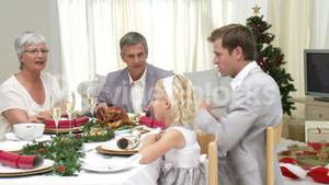 Family Sitting Down to Christmas Dinner