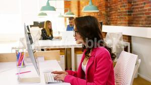 Female executive working on computer at desk