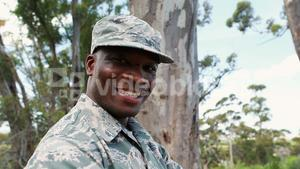 Portrait of military soldier standing with arms crossed