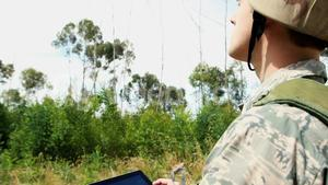 Military soldier using digital tablet during training exercise
