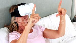Senior woman using virtual reality headset