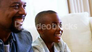 Happy father and son having fun in living room