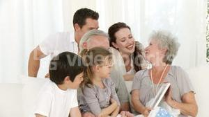 Grandmother looking at a photo with her family