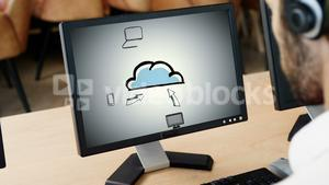 Executive looking cloud computing presentation on computer