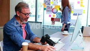 Male graphic designer working at desk