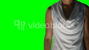Woman touching invisible against green screen background
