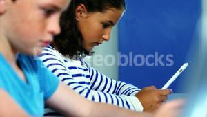 Student using digital tablet in classroom