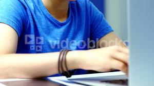 Student using laptop in classroom