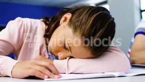 Tired student sleeping in classroom
