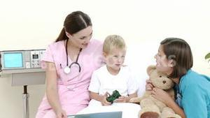 Little patient talking to a nurse and a pediatrician in hospital