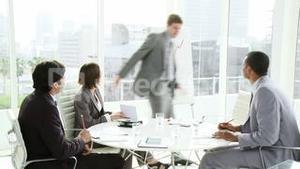 Multi ethnic business people coworkers interacting in a meeting