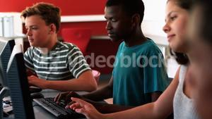 Students studying on computer in classroom