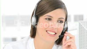 Businesswoman talking on a headset in the office