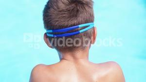 Boy relaxing near poolside