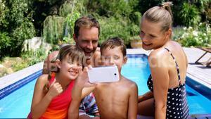 Happy family taking selfie from mobile phone