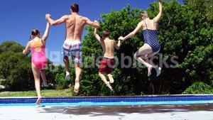 Rear view of family jumping in swimming pool