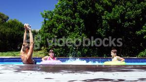 Happy family jumping in swimming pool
