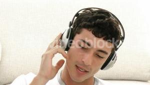 Male teenager listening to the music