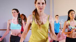 Group of women performing aerobics exercise