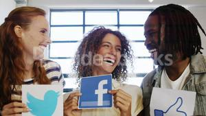 Happy executives holding social networking sign