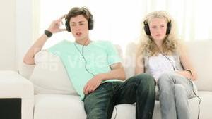 Teen Couple relaxing listening to music