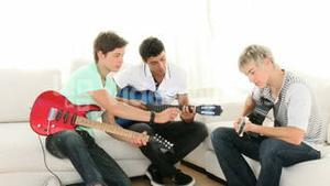 Teenagers Playing music at home