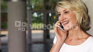 Happy executive talking on mobile phone
