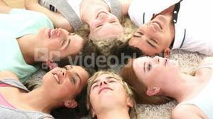 Teenagers with their heads together on the ground