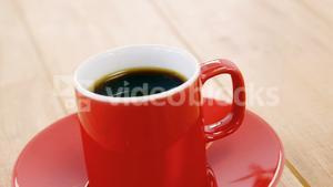 Black coffee served in red cup