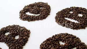 Coffee beans forming various faces