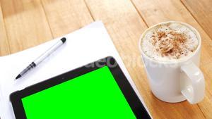 Coffee with digital tablet and paper