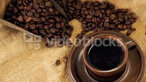 Black coffee, roasted beans and scoop on sack