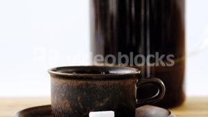 Cafetiere and a cup of black coffee on table