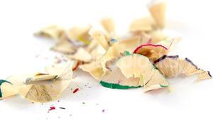 Colored pencils shavings on a white background