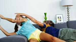 Siblings having fun together in living room